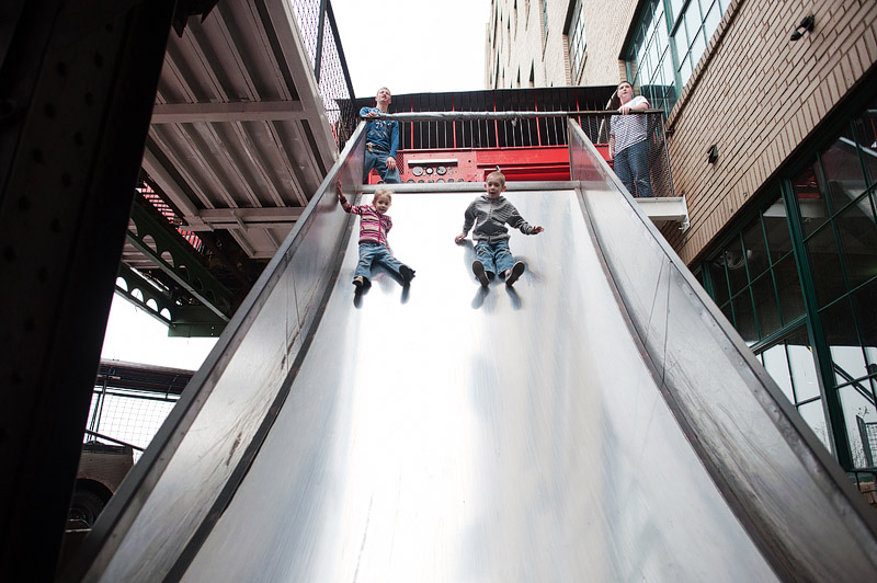 Kids on giant outdoor slide.
