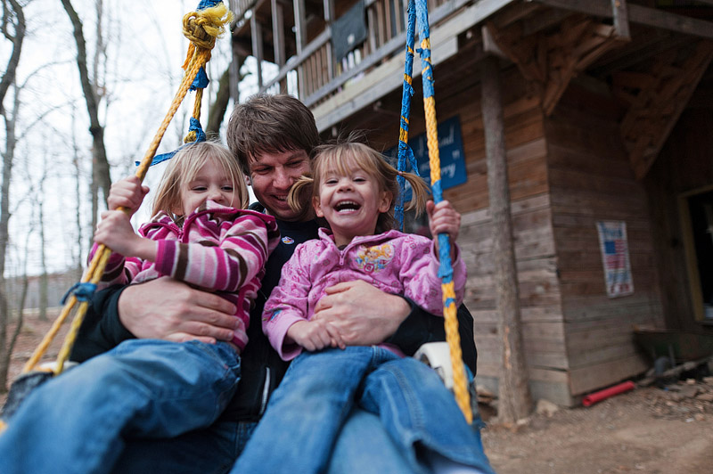 Dad and girls swinging at the ministers tree house in Crossville, TN.