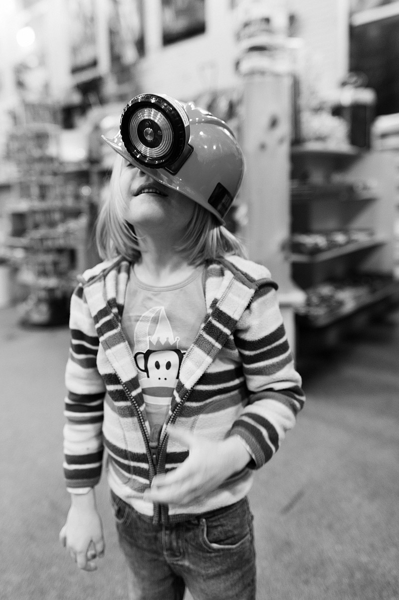 Girl with silly miners hat on.