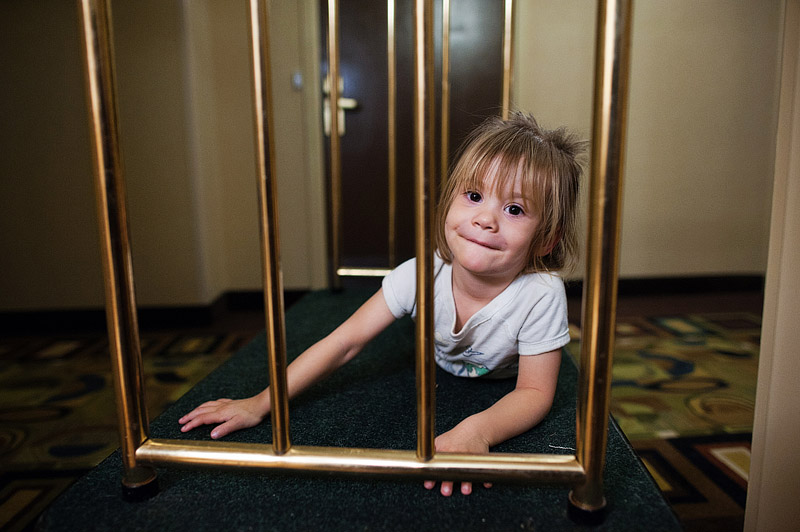 Girl on luggage cart at Holiday Inn Select in downtown St. Louis Missouri.