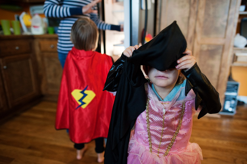 Toddler dressed as Sleeping Beauty and Batman.