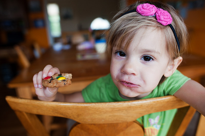 Toddler eating a cookie.