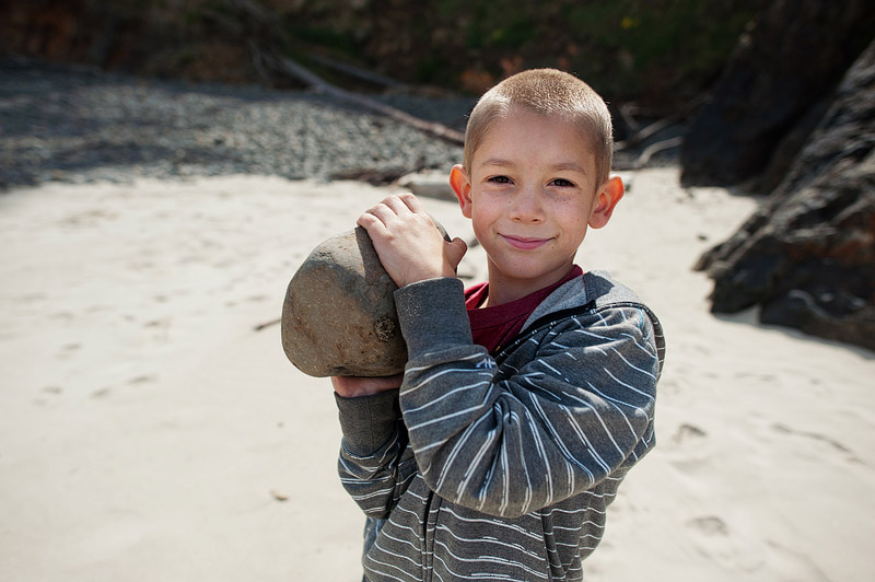 Boy holding a rock.