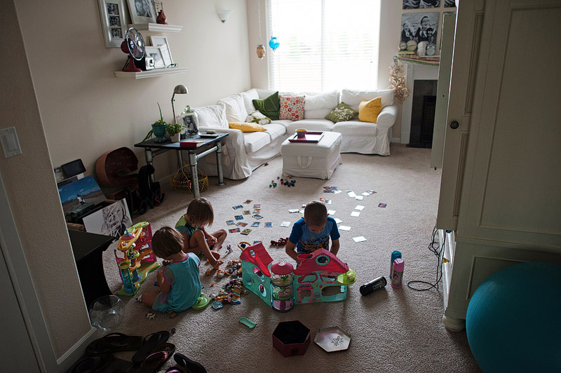 Kids playing with littlest pet shop toys.
