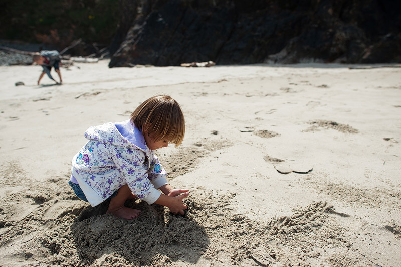 Toddler playing in the sand.