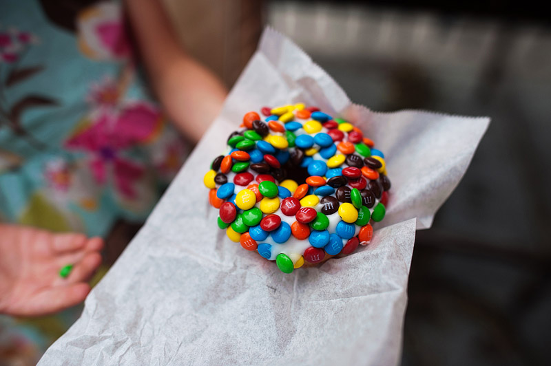 Girl holding donut covered in mini M&M's