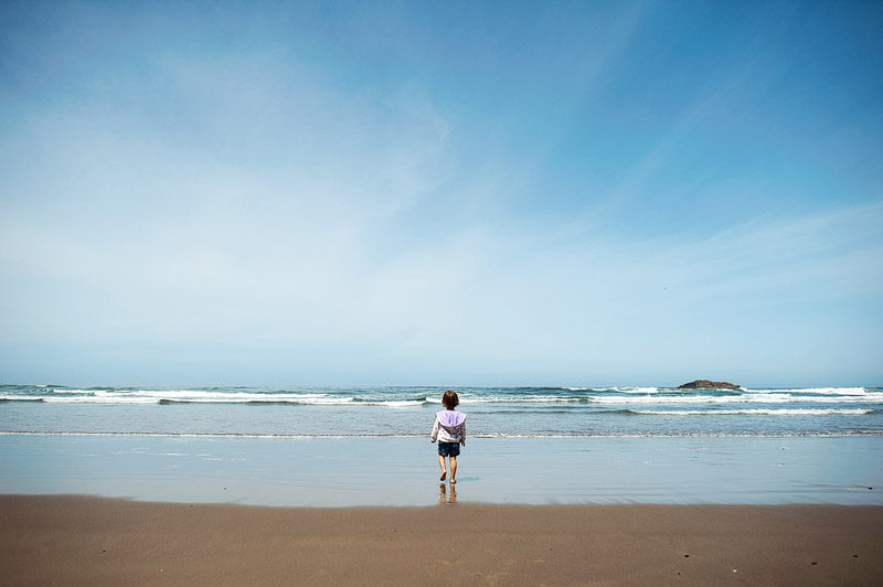 Toddler walking on an Oregon Beach.