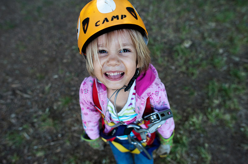Girl with helemt and harness on for ziplining at Out N About Treesort.