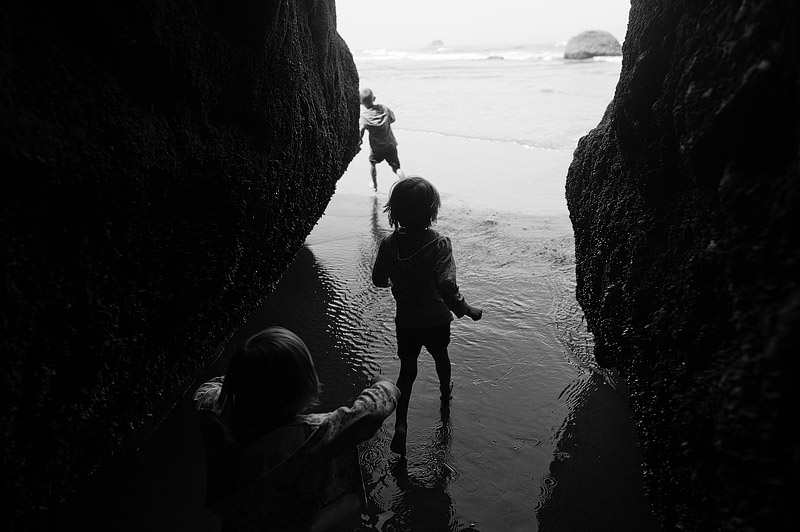 Kids playing in a cave in Oregon.