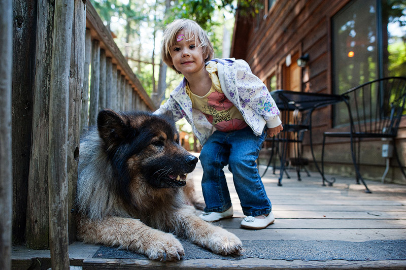 Girl petting dog at Out N About Treehouses.