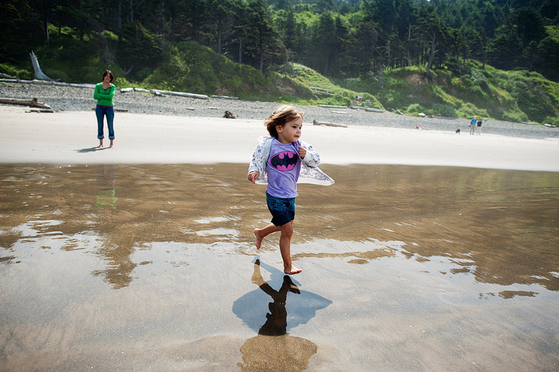 Toddler running into the ocean at Hug Point, Oregon.