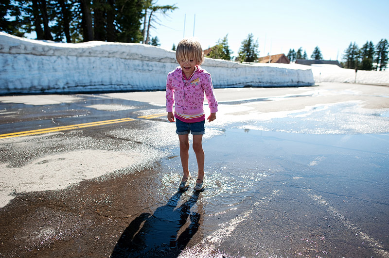 Girl splashing in a puddle.