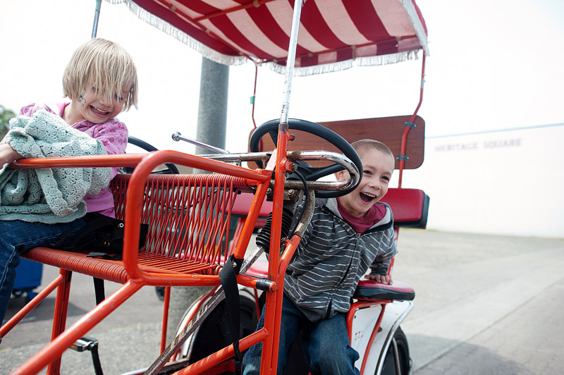 Boy playing on a Surrey in Seaside, Oregon.