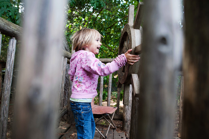 Girl playing in a pirate ship treehouse.