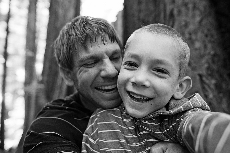 Dad and son laughing.