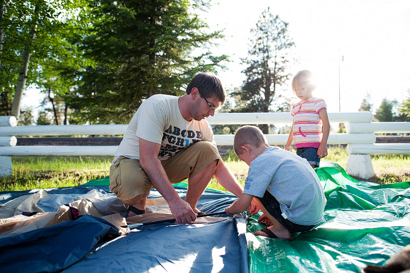 Family putting up tent at Crater Lake Resort in Ft. Klamath.