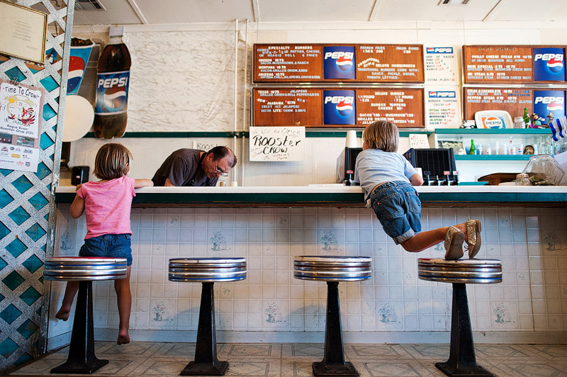 Kids waiting for food at Depot St. Burger restaurant in Rogue Valley.