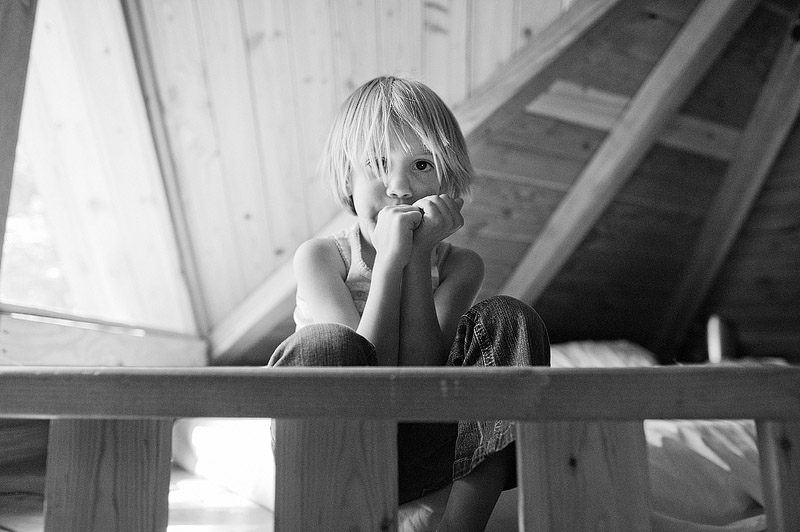 Portrait of a kid in an Out N About treehouse.