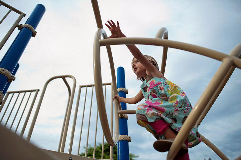 Girl climbing on playground.
