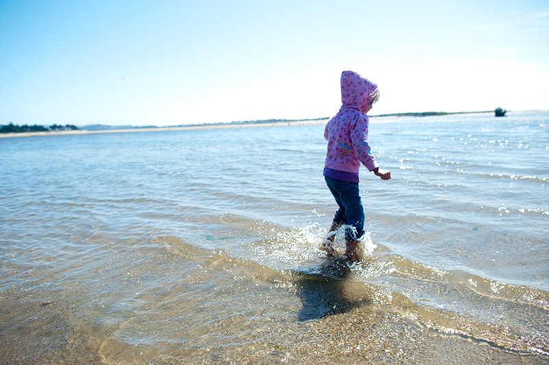Little girl splashing in the waves.