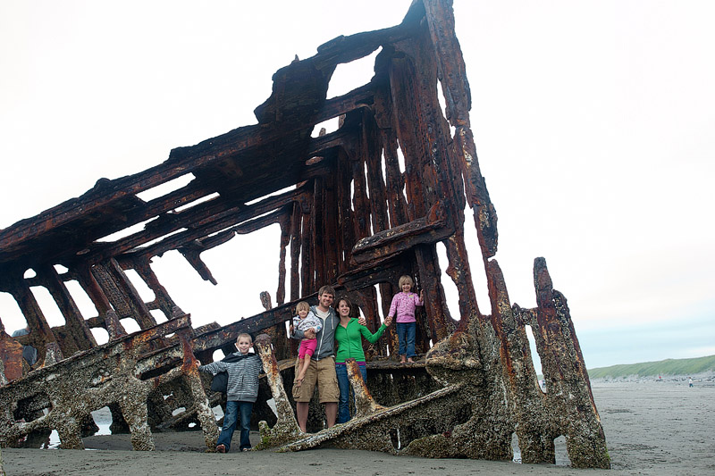 Family portrait in the wrecked Peter Iredale in Fort Stevens State Park.