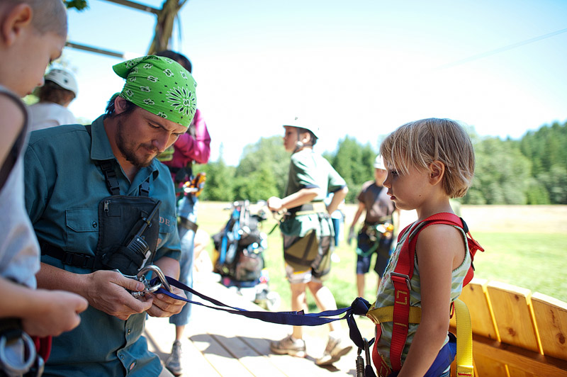 Girl getting ready to zipline.