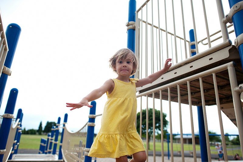 Girl running at playground.