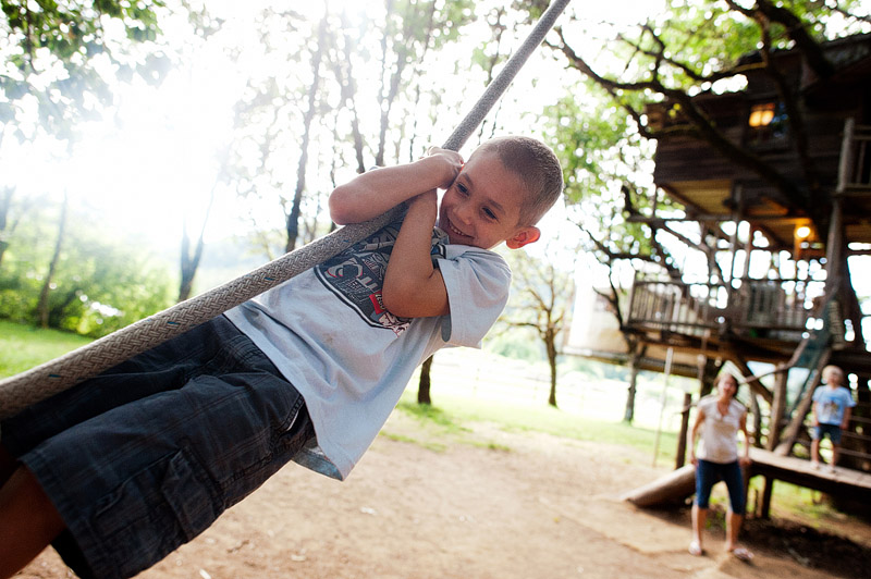 Boy on a rope swing at Out N About Treehouses.