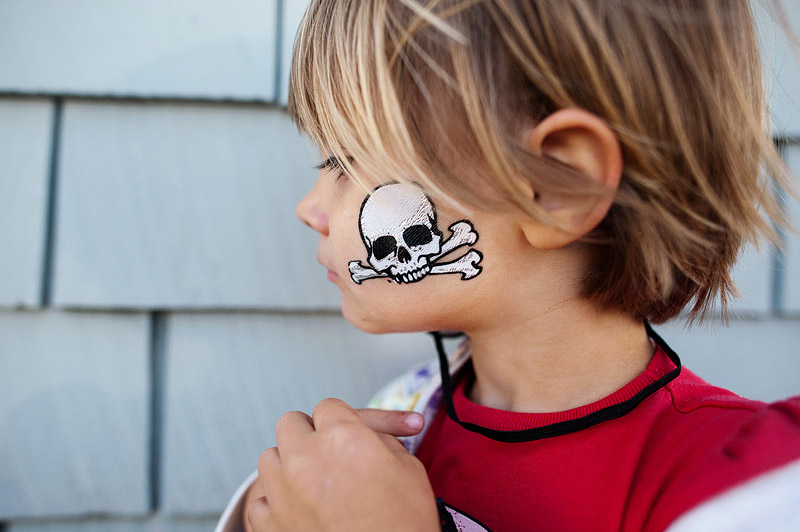 Toddler wearing pirate tattoo.