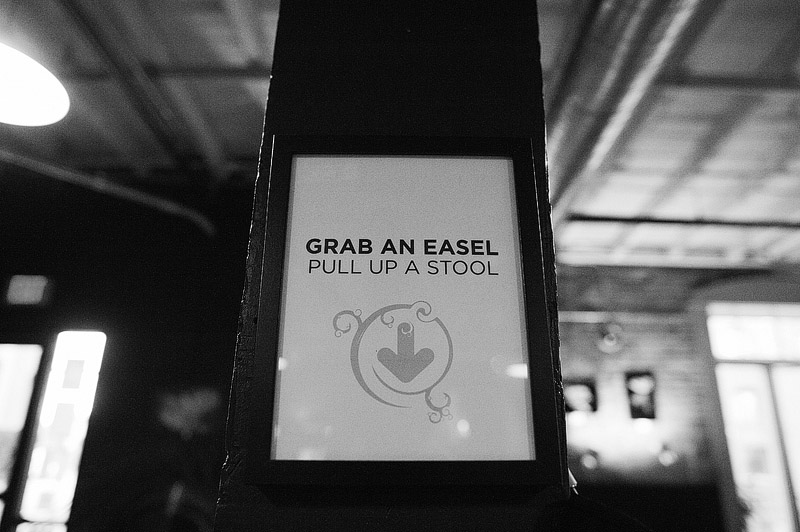 Grab and easel sign at the canvas.