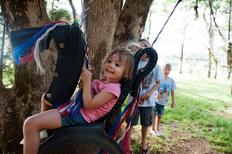 Toddler on a horse swing.