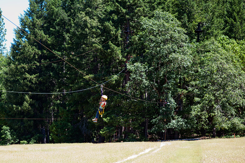 Little girl zip lining.