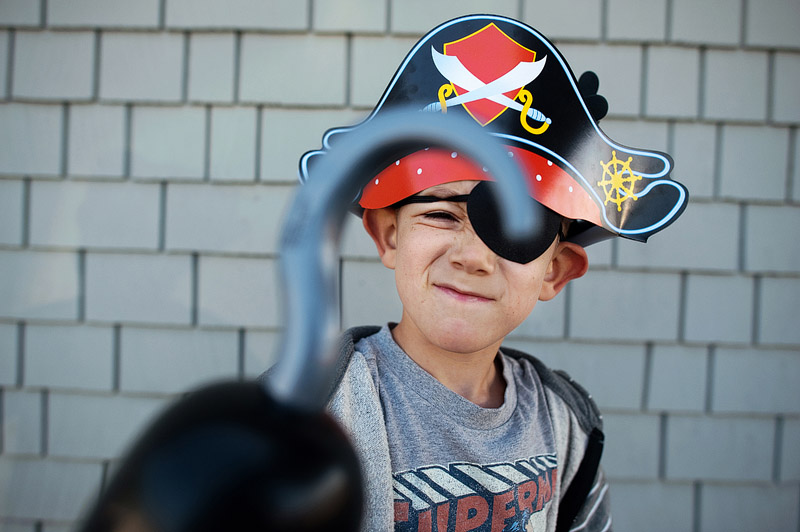 Pirate boy with hook and eye patch.