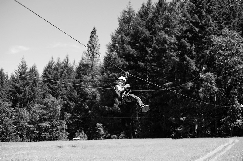 Boy riding a zip line.