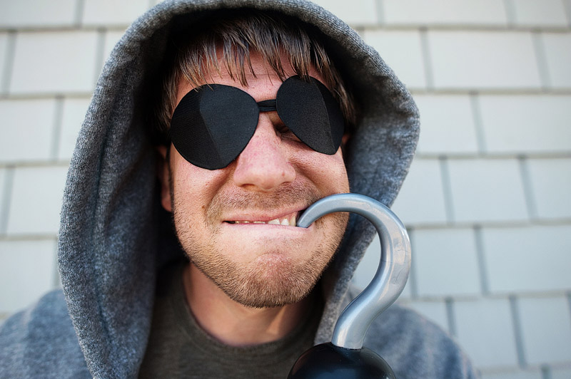 Man dressed as pirate with two eye patches.