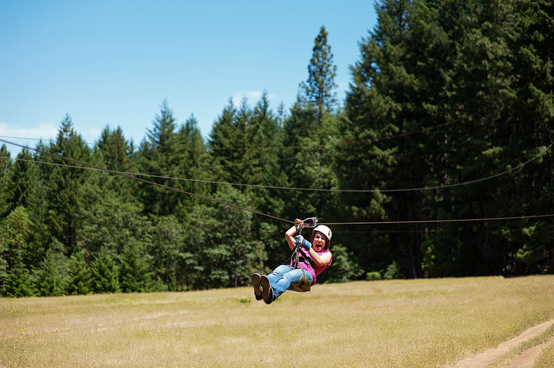 Woman on a zip line.