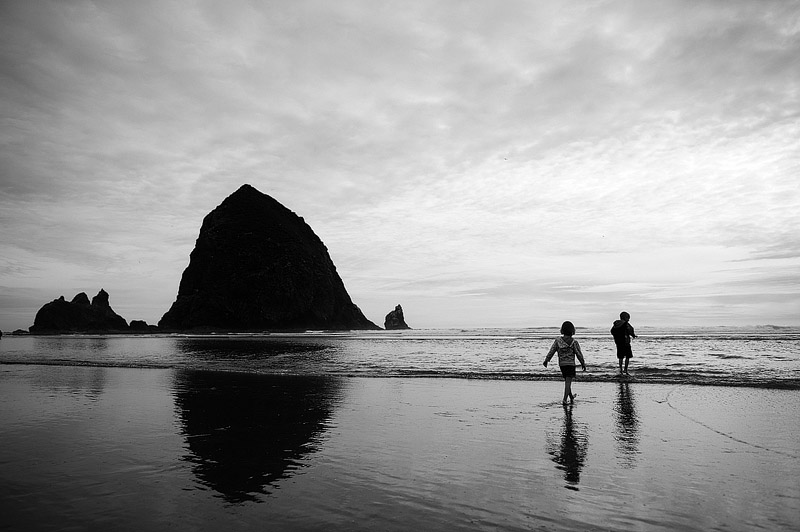 Kids playing on Cannon Beach in Oregon.