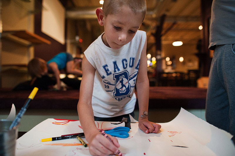 Boy drawing at the canvas in Portland, Oregon.
