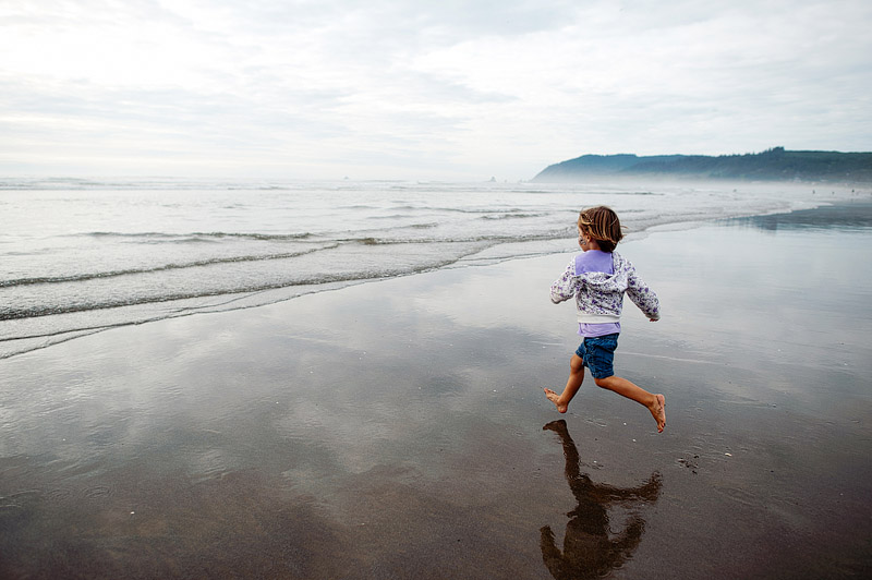 Toddler running on Cannon Beach, Oregon.