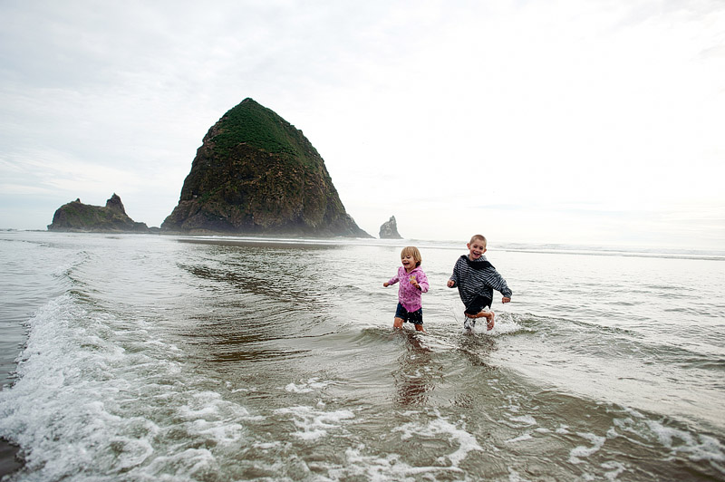 Kids running in the Ocean at Cannon Beach.