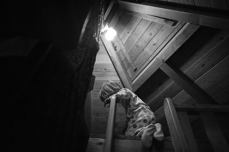 Toddler in a tree house.