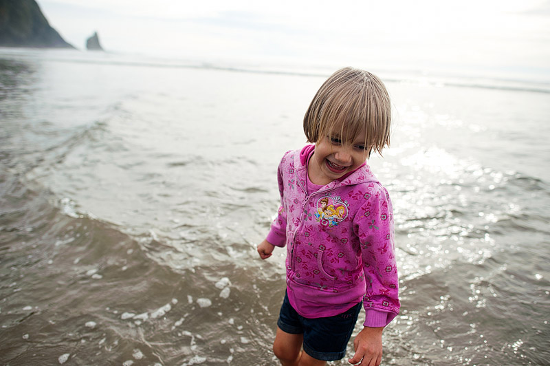 Girl playing in the Pacific Ocean.