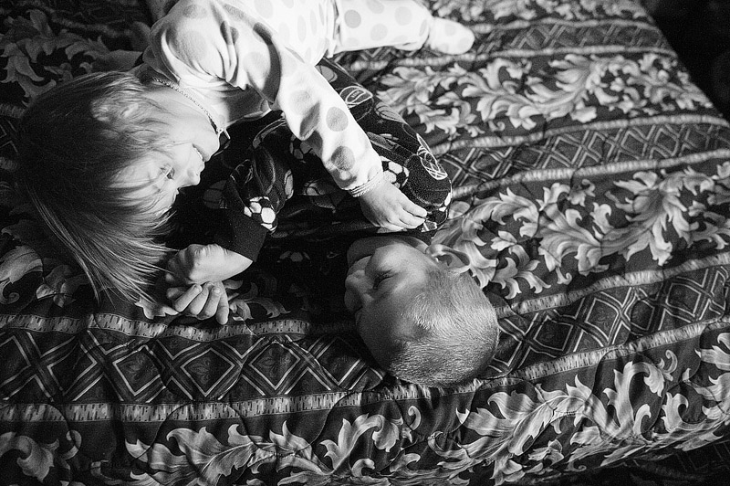 Little sister tickling her brother.