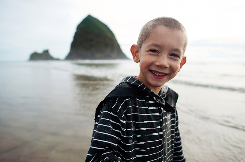 Portrait of a boy on Cannon Beach Oregon at sunset.