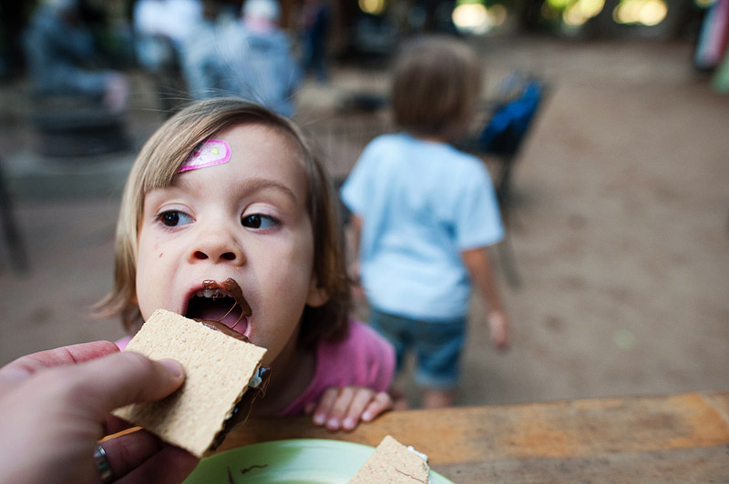 Toddler eating s'mores.