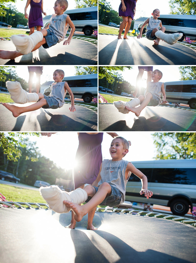 kid with splint bouncing on trampoline with mom