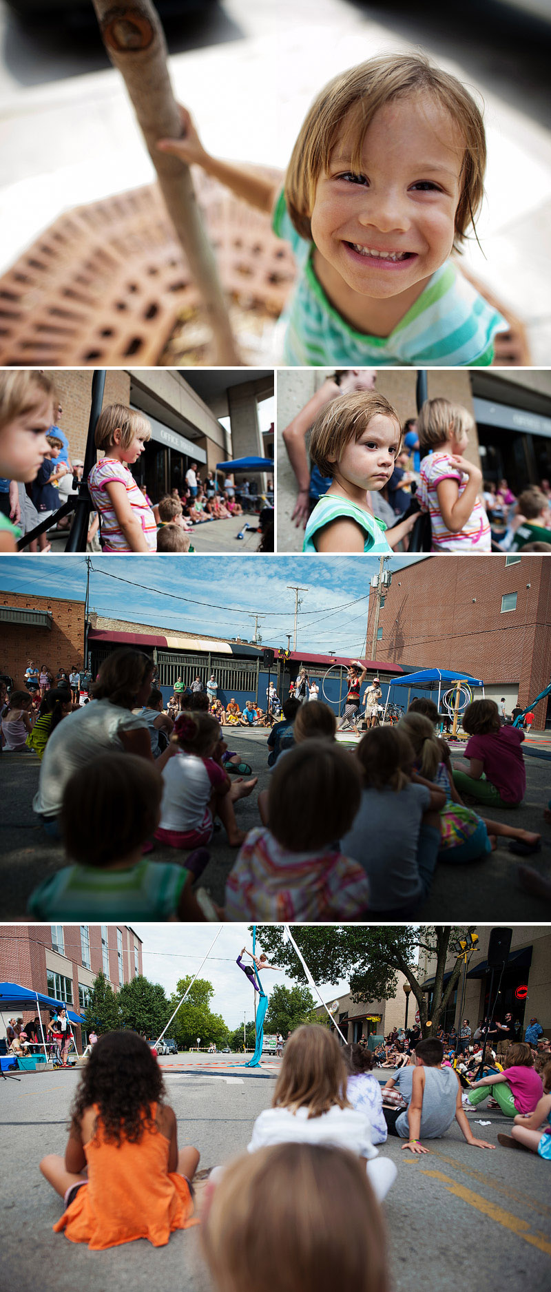 kids watching street performers in lawrence
