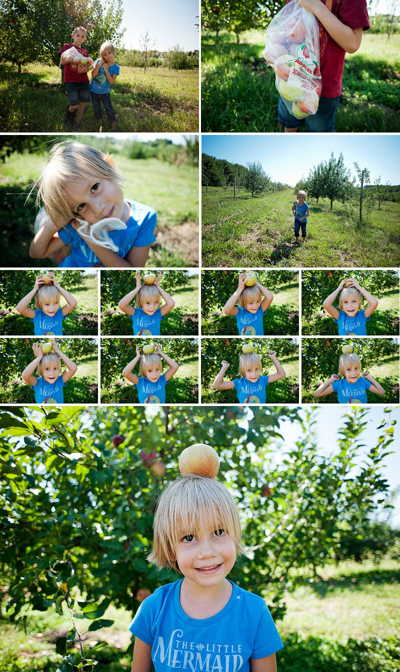 little girl balancing apple on her head