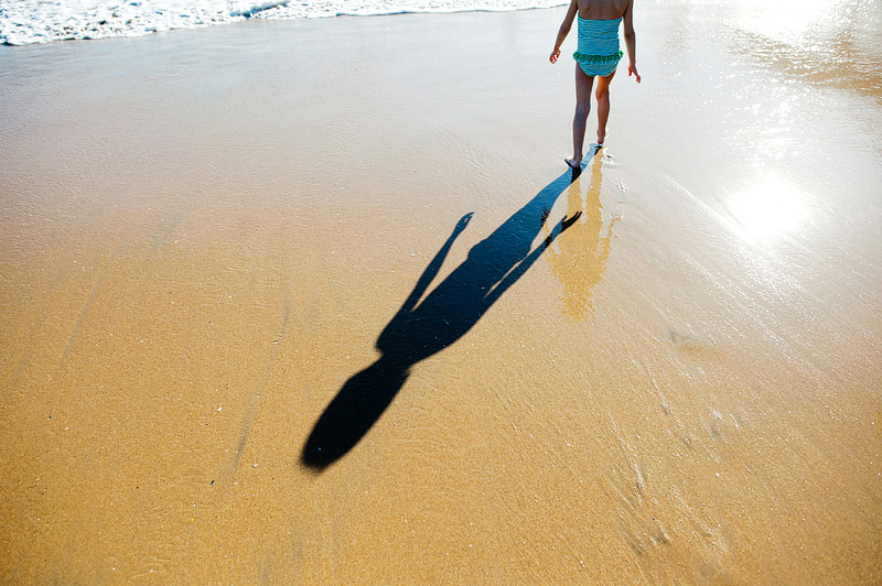 Girl shadow on the beach.