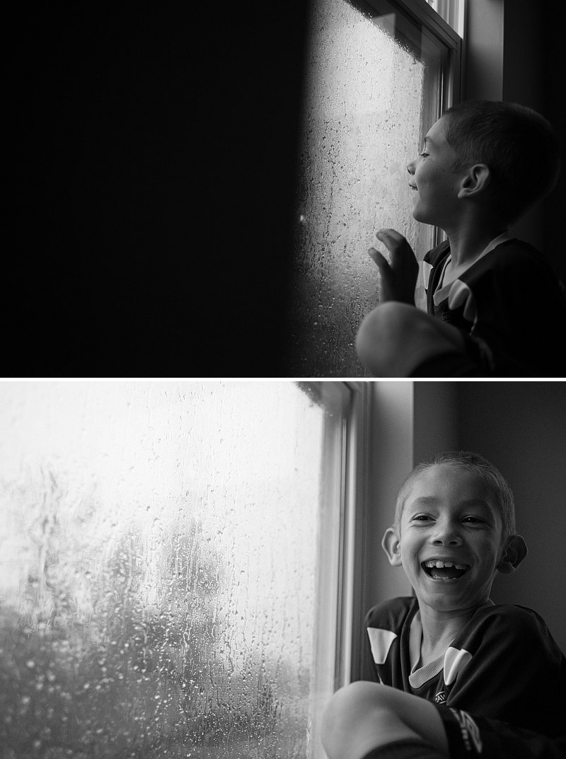 Boy looking at thunderstorms with wonder.